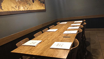 Empty table with copies of Local 2960's final contract