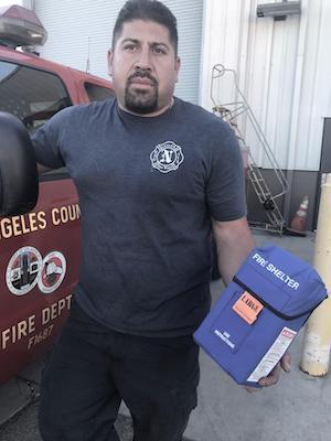 AFSCME member Frankie Martinez standing in front of a LA Co. Fire Department vehicle